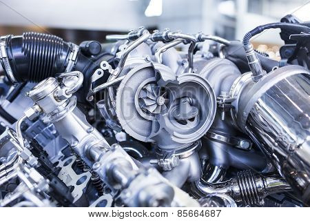 Turbo car engine showing parts and turbine dealer service workshop stock photo