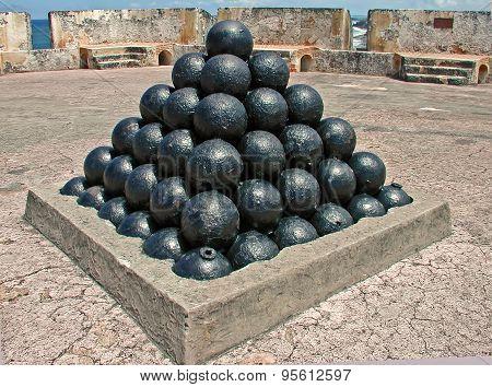 A photograph of cannon balls on display inside Fort San Cristobal San Juan Puerto Rico stock photo