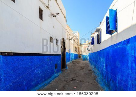 Small streets in blue and white in the kasbah of the old city Rabat in Marocco on a sunny day stock photo