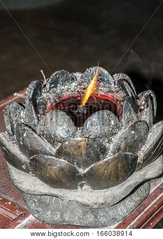 China the Shaolin Monastery. Inextinguishable fire in the bronze lotus for kindling incense in the temple. stock photo