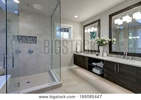 Spacious Bathroom In Gray Tones With Heated Floors