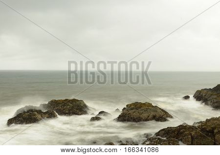 Waves crash against the rocks on the coast at Elie in Fife stock photo