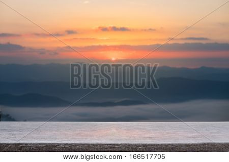Selective foucus on Empty wooden table with the sunrise mountain view background. For display or montage your products. stock photo
