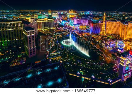 The Las Vegas Strip as seen from the Cosmopolitan hotel with view onto Bellagio hotel and casino, Bellagio fountains, Paris hotel and casino, Caesars, and many others.
