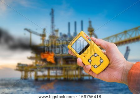 Safety concept of fire in oil and gas petrochemical industry gas detector checking gas leaking before working to prevent fire case. stock photo