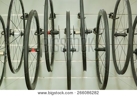 Bicycle wheels hung on the wall / Different types of road bike wheel stock photo