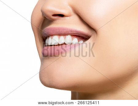 Smiling happy woman. Laughing female mouth with great teeth over white background. Healthy beautiful smile. Teeth health, whitening, prosthetics and care.  stock photo