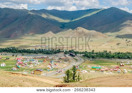 Countryside landscape with colorful houses in small rural riverside settlement in valley near capital Ulaanbaatar in Mongolia stock photo