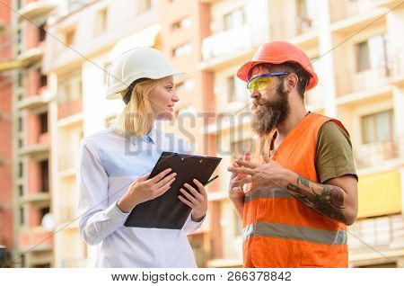 Construction industry. Successful deal concept. Foreman established supply of building materials. Expert and builder communicate about supply building materials. Purchase of building materials stock photo