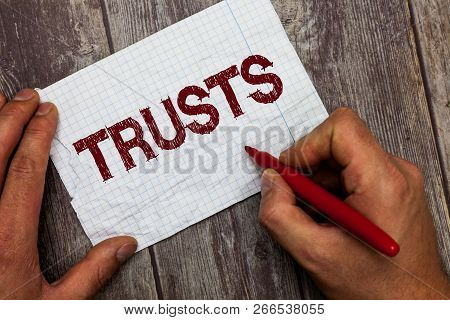 Handwriting text Trusts. Concept meaning firm belief in reliability truth or ability of someone or something stock photo