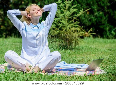 Clear your mind. Girl meditate on rug green grass meadow nature background. Find minute to relax. Woman relaxing practicing meditation. Every day meditation. Reasons you should meditate every day stock photo