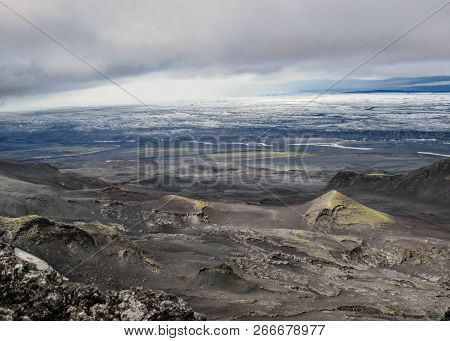 Dramatic panorama of volcanic features and Vatnajokull glacier melting under the summer sun, remote part of the central highlands of Iceland, Vatnajokull National Park, Europe stock photo