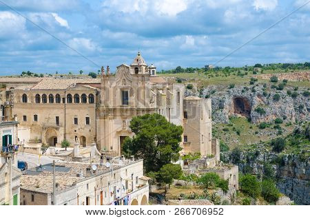 Convent of Saint Agostino church in historical centre Sasso Barisano of old ancient town Sassi di Matera with caves background, Basilicata, Southern Italy stock photo