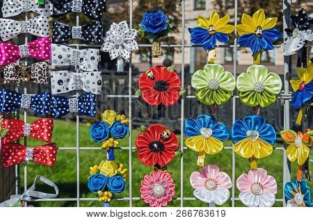 Clips for hair from satin ribbons, plastic and other costume jewelry handmade of different colors stock photo