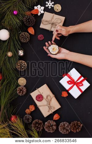 Christmas background new year winter tree gifts nuts bumps hands stock photo