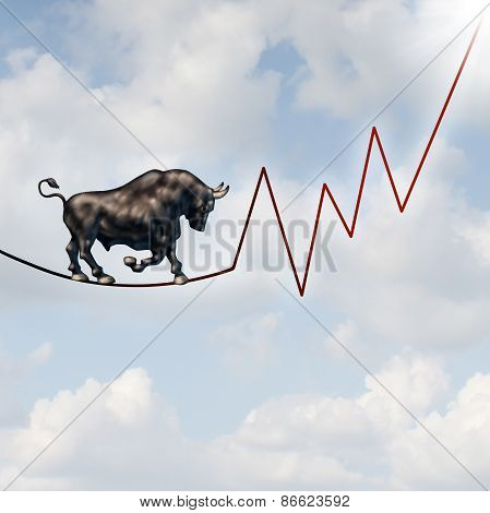 Bull market risk financial concept as a heavy bullish beast walking on a high tightrope shaped as a stock market profit chart representing the investment danger ahead. stock photo