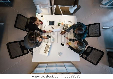 Multi-ethnic Business People Discussing In Board Room Meeting