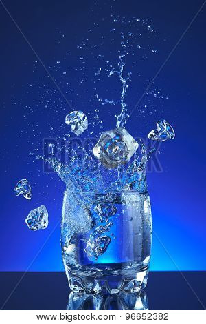Water splash poured into a glass, blue background, refreshing, freshness and health. Water bottle,-Mini Fridge Magnet Skin (size 20x31)
