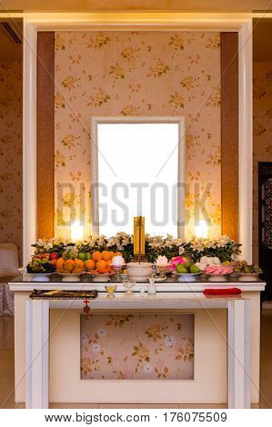 Traditional Chinese Mourning Hall with blank photo frame and floral and fruit decoration. stock photo