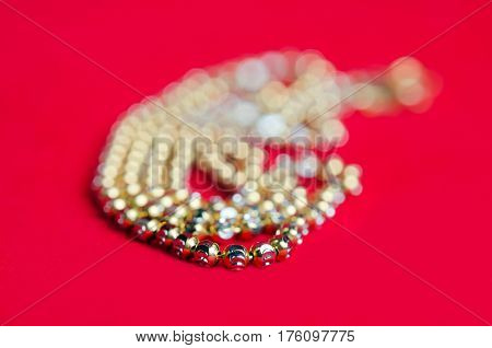 Gold necklace 96.5 precent Thai gold design with gold heart pendant isolated on red flannel cloth stock photo