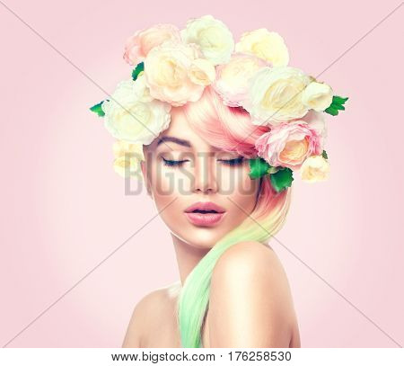 Spring Woman. Beauty Summer model girl with colorful flowers wreath and colorful hair. Flowers Hair