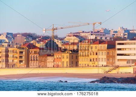 Airplane flying above the Matosinhos - Porto luxury district. Portugal stock photo