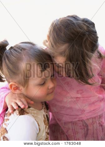 Two young sisters were together on the road. stock photo