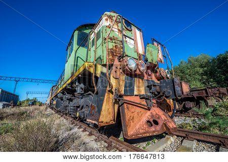 Rusty locomotive on deserted Yaniv railroad station near Pripyat city in Chernobyl Exclusion Zone Ukraine stock photo