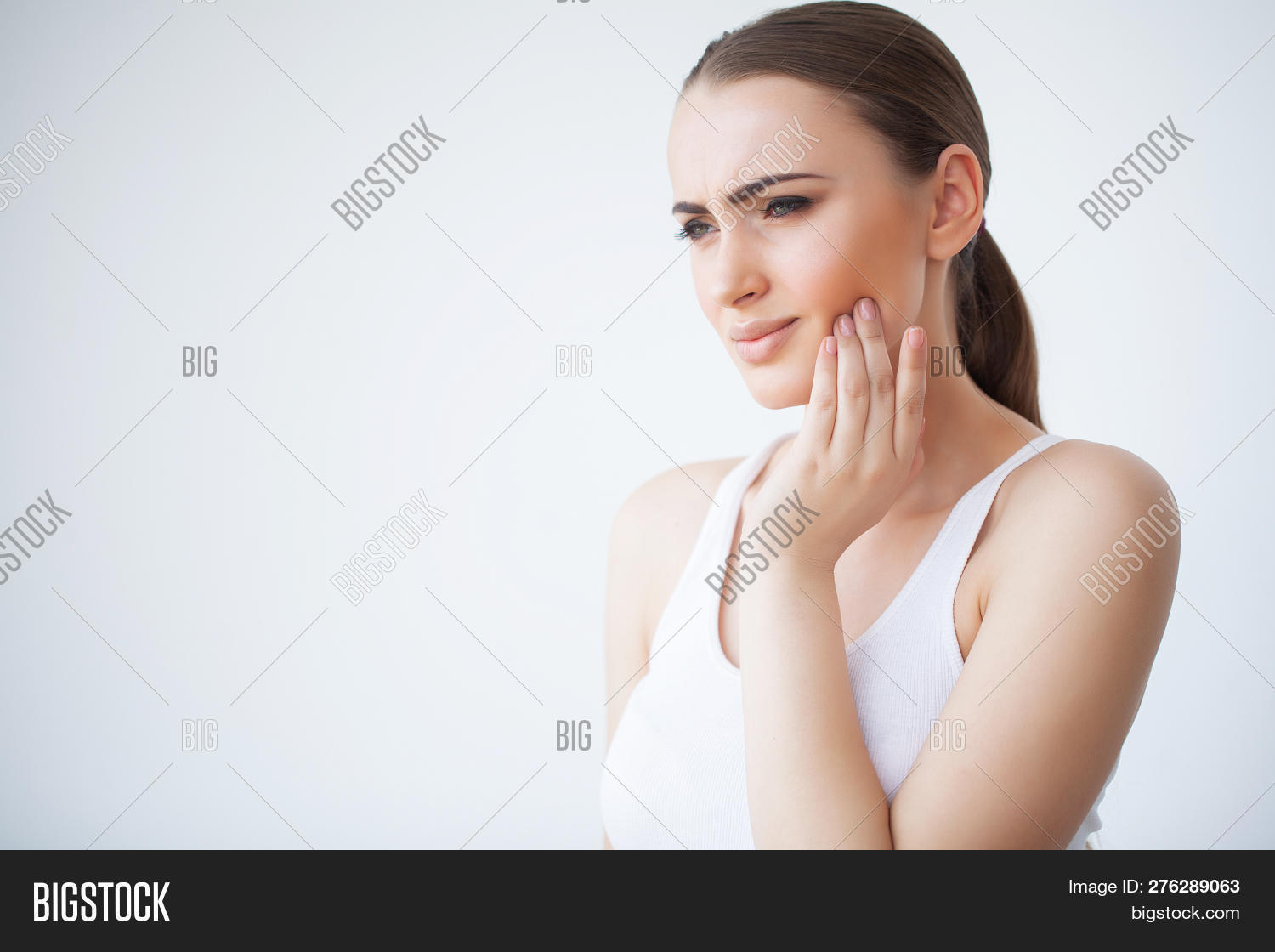 Tooth Pain. Dental Care And Toothache. Woman Feeling Tooth Pain. Closeup Of Beautiful Sad Girl Suffe