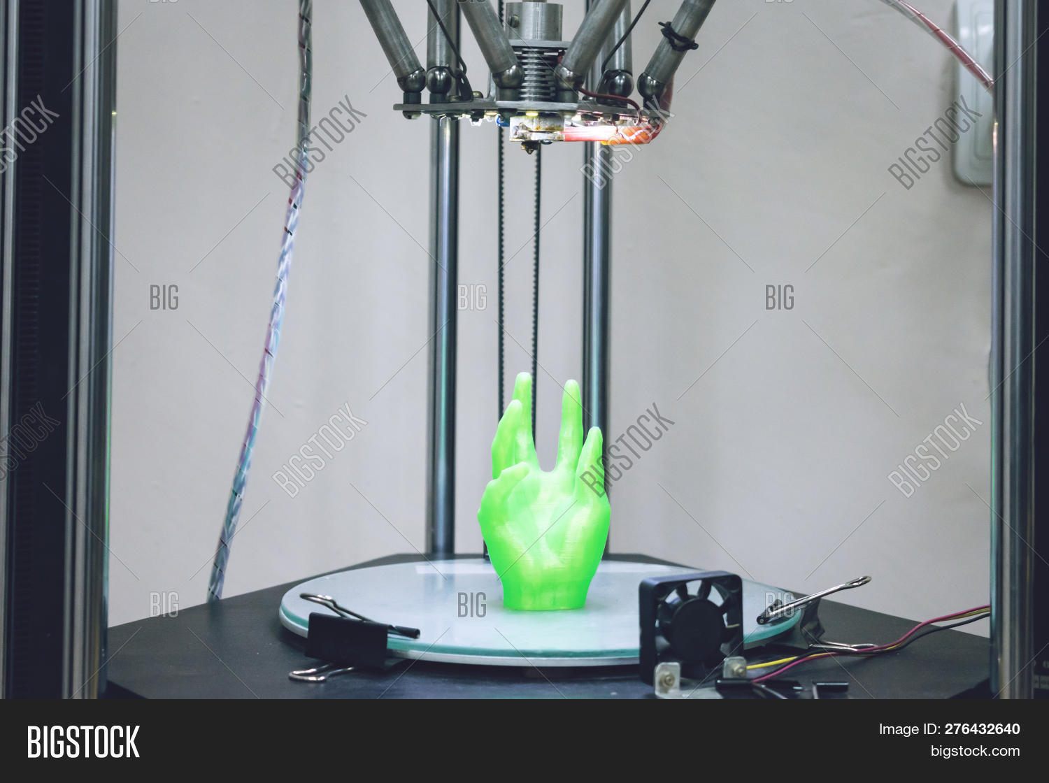 Green Plastic 3D Printed Human Hand Stands In Three-dimensional Printer. Object Model Printed On Aut