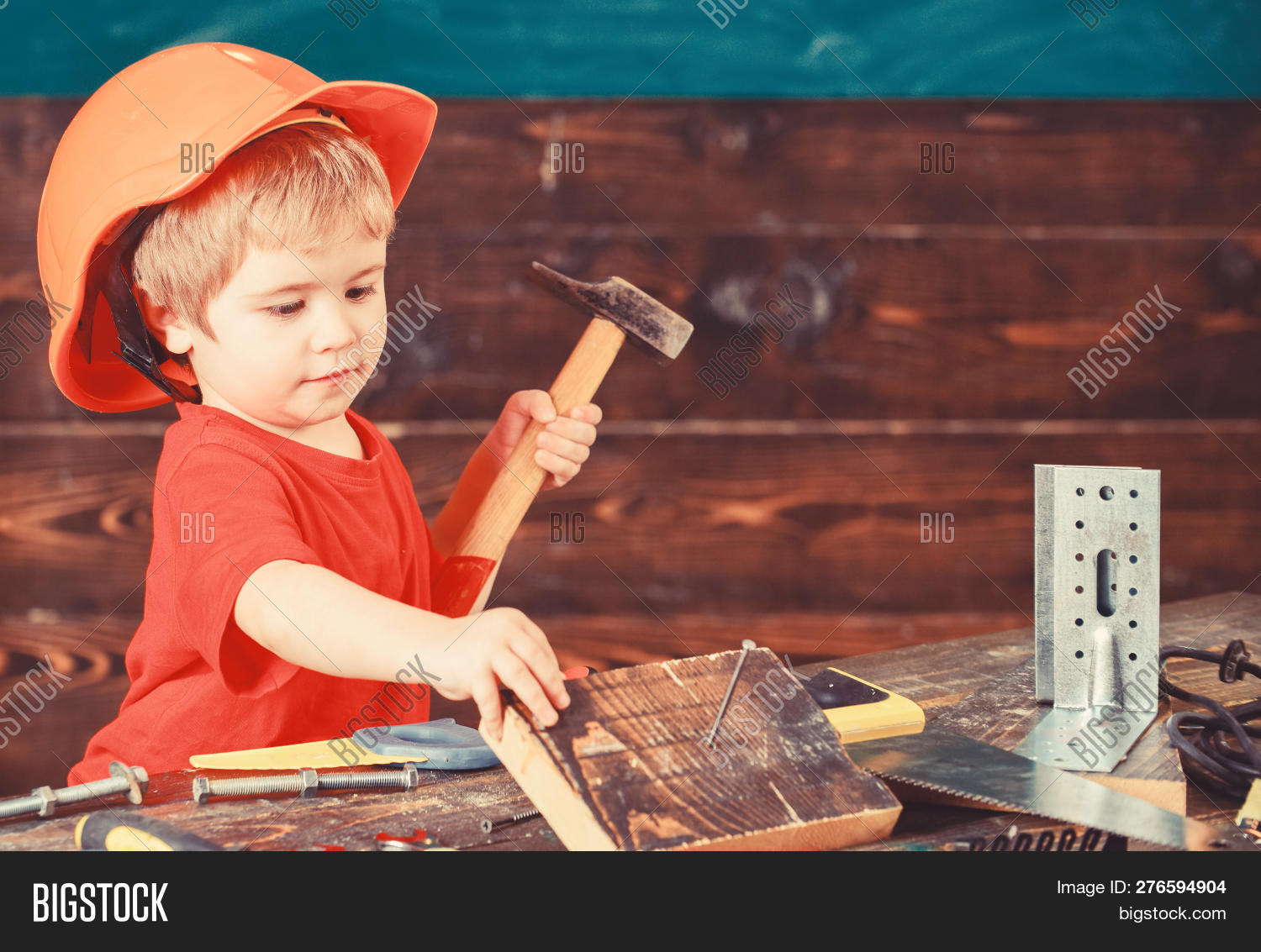 activity,adorable,background,board,boy,build,builder,busy,carpenter,caucasian,child,childhood,concept,construction,craft,cute,detail,education,engineer,equipment,future,game,hammer,hammering,handcraft,handyman,helmet,home,instrument,kid,labor,laborer,learn,little,nail,play,preschooler,profession,professional,repair,repairer,safety,small,toddler,tool,use,wooden,work,workshop
