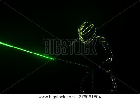 Neon man silhouette dark play laser show color light stock photo
