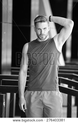 Man unsatisfied his antiperspirant. Sportsman after training feel sweat smell. Guy check armpit sweaty skin. Prevent or reduce perspiration. Choose proper antiperspirant or deodorant for training. stock photo