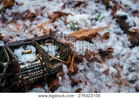 old tv tuner channel selector with moss and snow in the forest stock photo