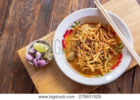 Khao Soi. Curried Noodle Soup Thailand call Khao Soi. Khao Soi thai food style. Noodle Curry Soup or Khao Soi with chicken. Khao soi Traditional Thai Food. Thai noodle curry soup with chicken. stock photo