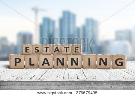 Estate planning sign on a wooden pier with tall buildings in the background stock photo