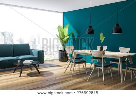 Modern dining room interior with blue walls, wooden floor, wooden table with black and beige chairs around it and vertical poster. 3d rendering mock up stock photo