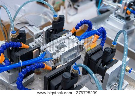 robotic and pneumatic piston sucker unit on industrial machine,automation compressed air factory production stock photo