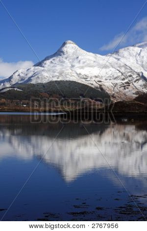 The Paput of Glencoe reflected in Loch Kinlochleven stock photo