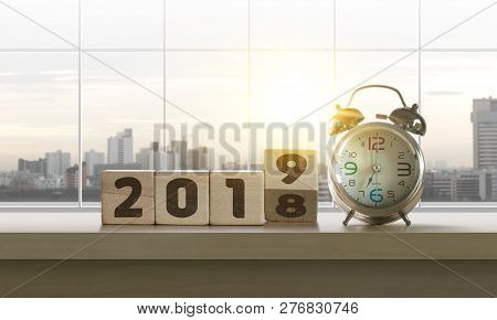 Wooden blocks with the word 2019 and clock on table with panoramic city skyline background in the morning. Happy New Year, start up, refresh, mindset concept. stock photo