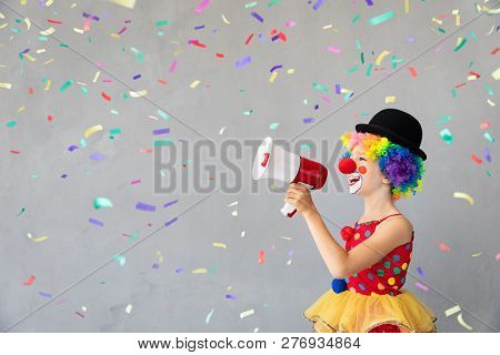 Funny kid clown. Happy child playing at home. 1 April Fool's day concept stock photo