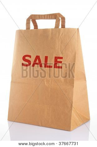 a brown used paper bag on white background stock photo