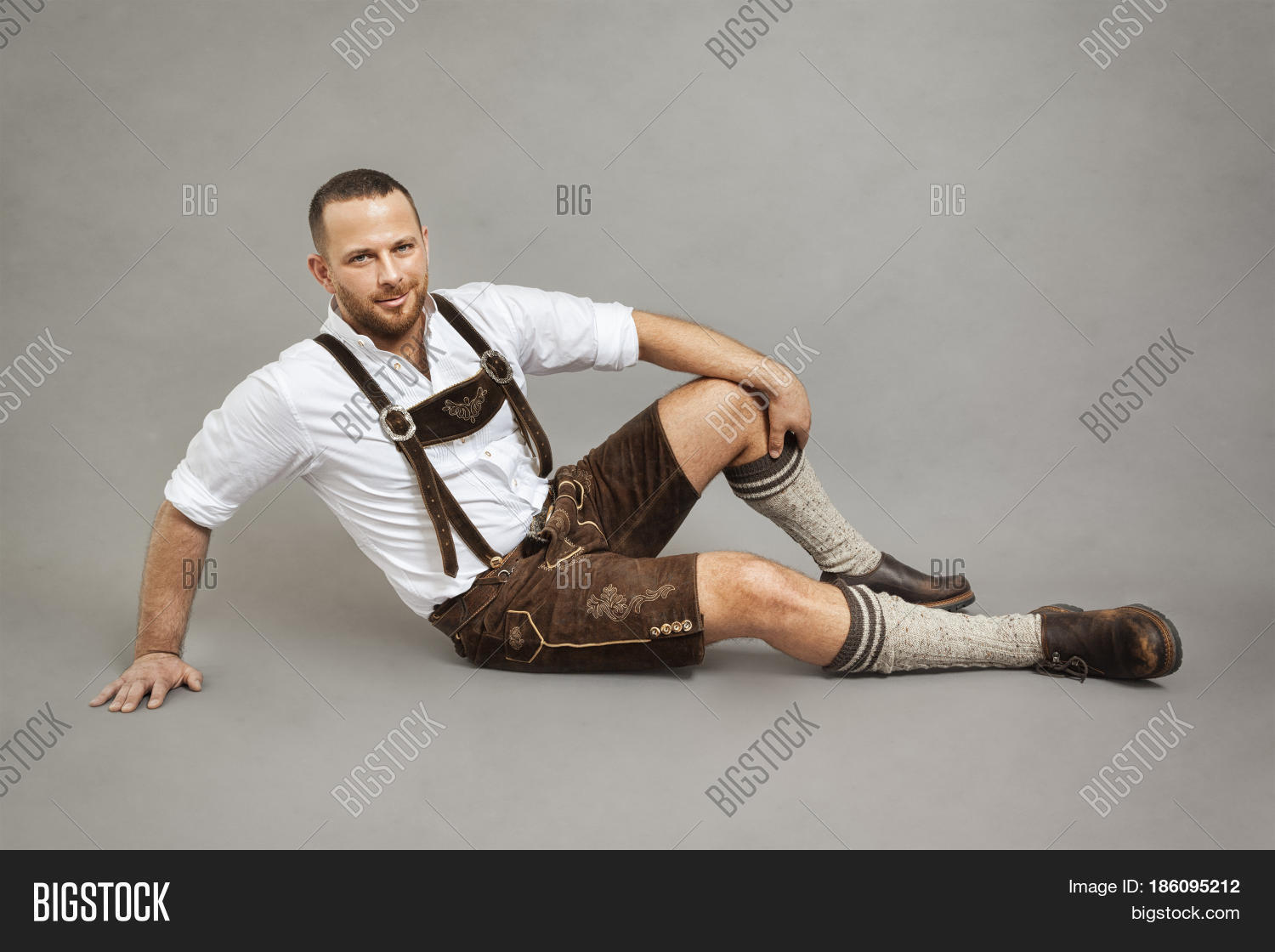 alone,alpine,bavarian,bearded,brown,caucasian,clothes,comfort,costume,enjoy,festival,fun,german,grey,guy,handsome,happy,horizontal,isolated,leather,lederhosen,leisure,lying,male,man,national,oktoberfest,person,portrait,posing,relax,rest,smart,smile,studio,suspenders,traditional,typical,young