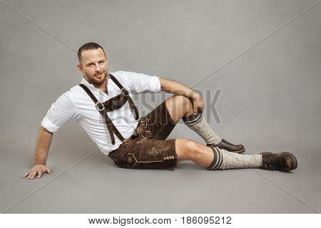 An image of a man in bavarian traditional lederhosen stock photo