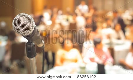 Business meeting and event on stage concept - Close up head of microphone on stage of business meeting or event whit flare light effect and copyspace