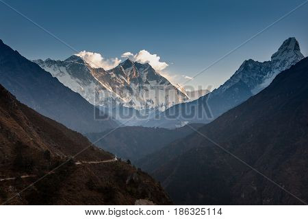 View Over The Hill With Mountain Trail And Snowy Mountains On The Background. Ama Dablam And Lhotse