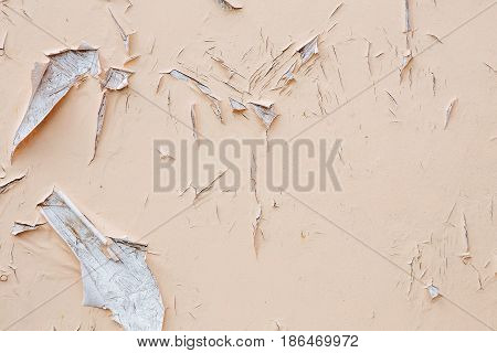 Cracking and peeling paint on a wall. Vintage wood background with peeling paint. Old board with Irradiated paint stock photo