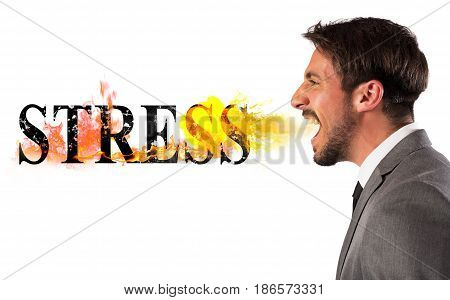 Businessman burns the word stress. stressed business life concept stock photo
