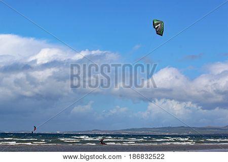 kitesurfer riding his board in Swansea Bay stock photo
