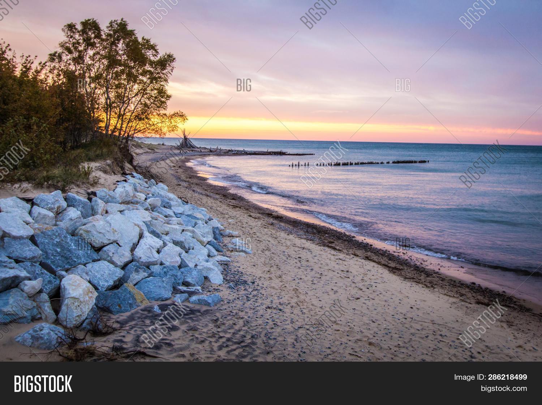 Michigan Beach Sunset. Sunset On The Wild Coast Of Lake Superior With Beach Hut On The Horizon In Th